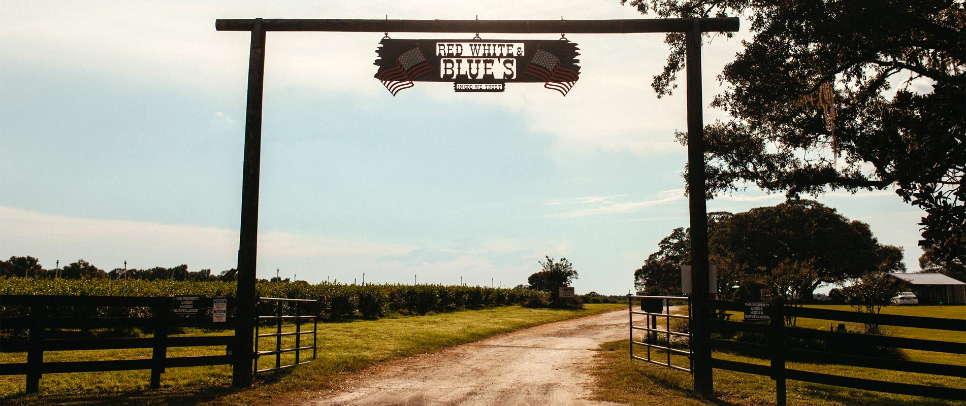 Entrance of Red, White and Blues Farm, In God We Trust